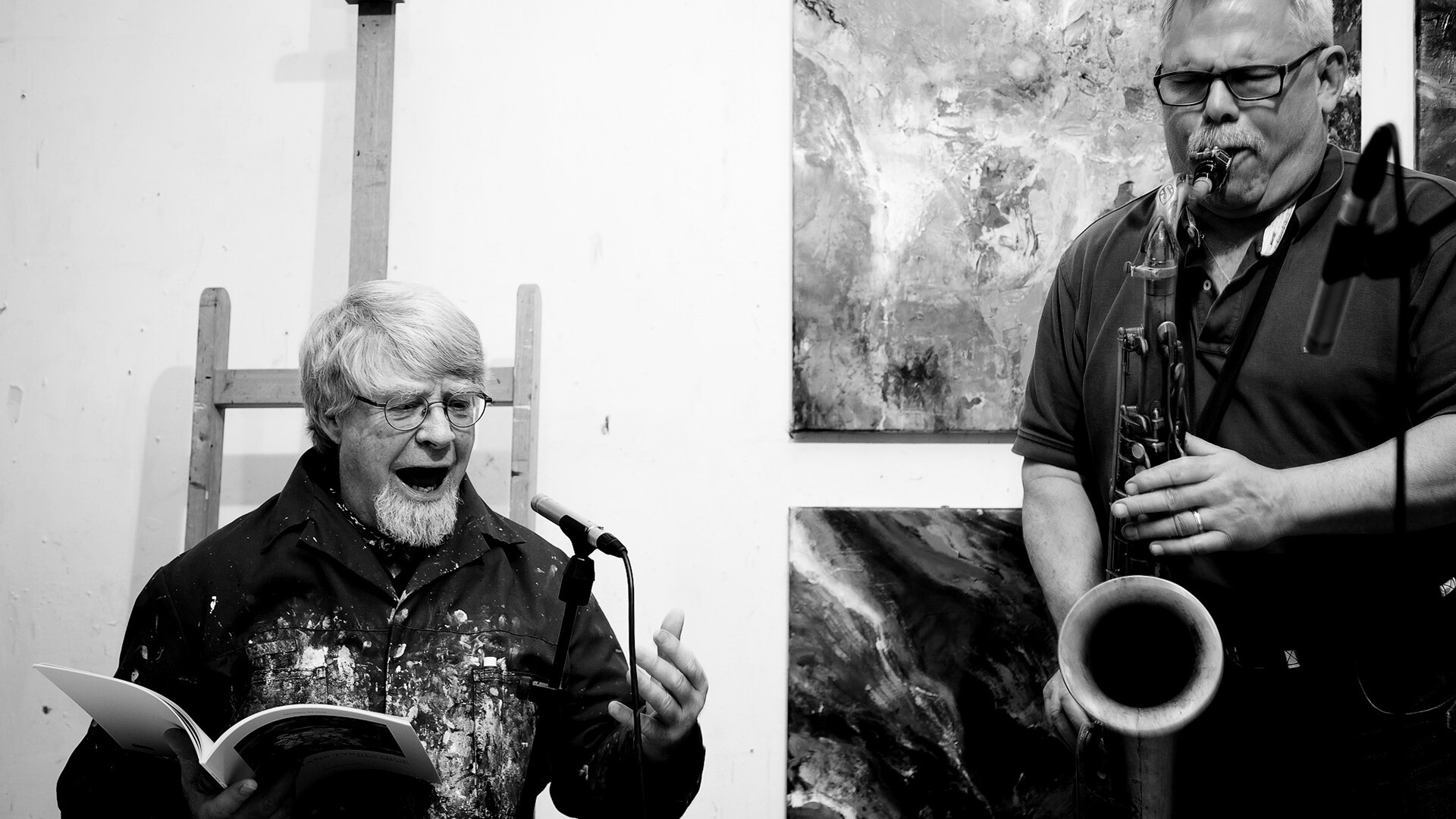 Picture of Marc Bernstien and Hans Tyrrestrup playing and reciting